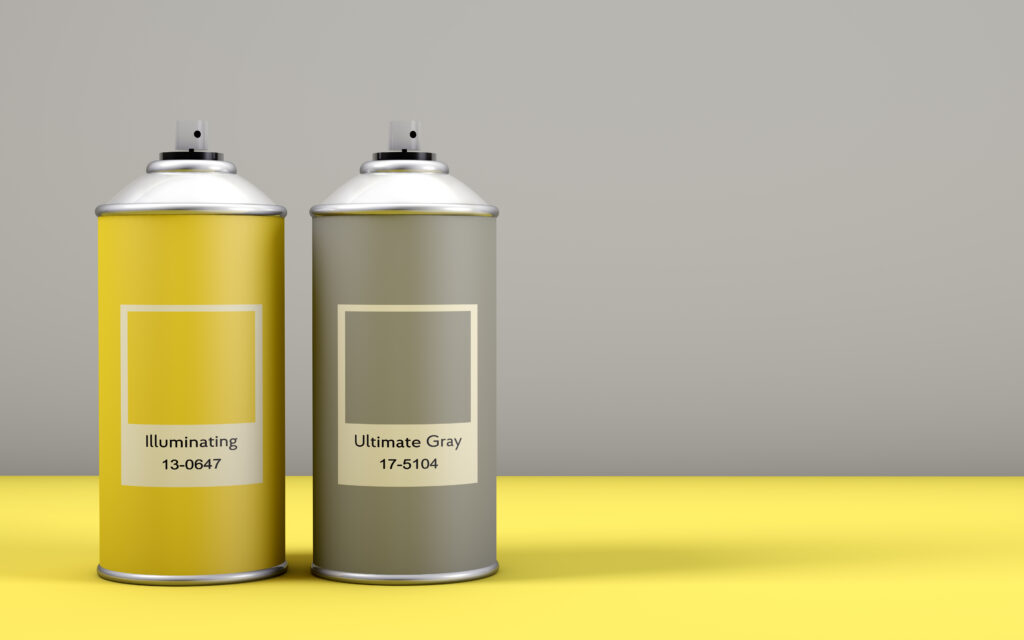 Spray paint cans with the colors of the year 2021 called Illuminating Yellow and Ultimate Gray with copy space. This union of colors conveys a message of strength and hope. 3d render